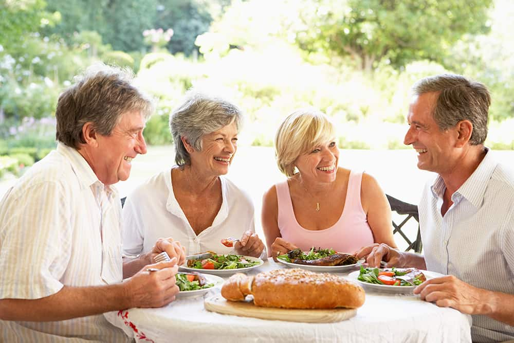 Middle aged women are only happy when eating salad surrounded by handsome men